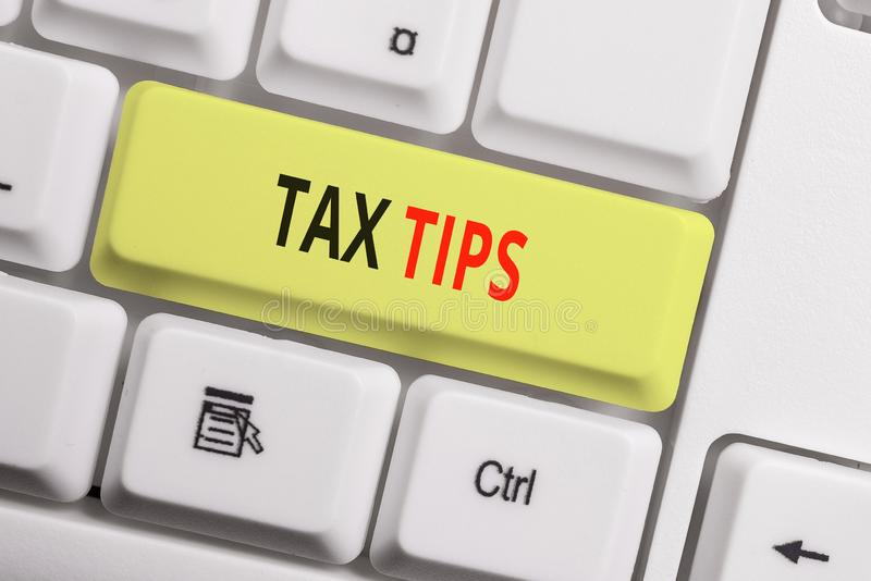 Text sign showing Tax Tips. Conceptual photo compulsory contribution to state revenue levied by government White pc. Text sign showing Tax Tips. Business photo stock images