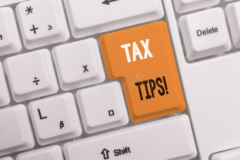 Text sign showing Tax Tips. Conceptual photo compulsory contribution to state revenue levied by government White pc. Text sign showing Tax Tips. Business photo stock photos