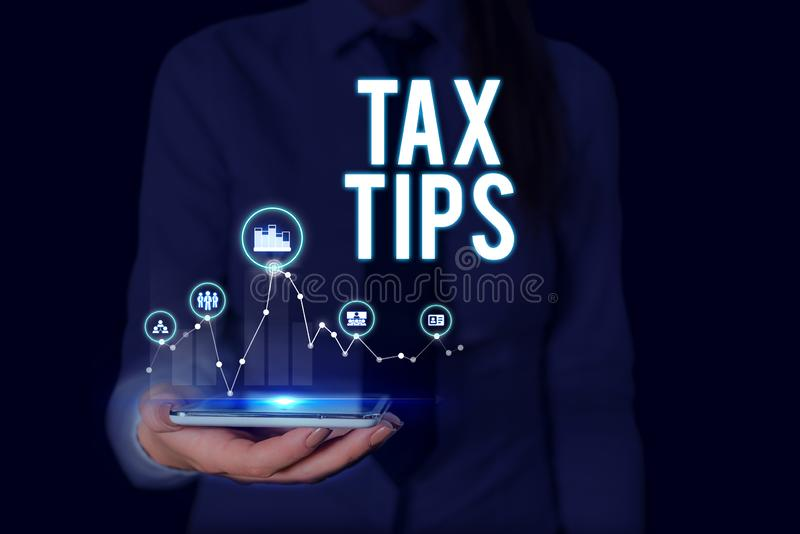 Text sign showing Tax Tips. Conceptual photo compulsory contribution to state revenue levied by government Woman wear. Text sign showing Tax Tips. Business photo stock image