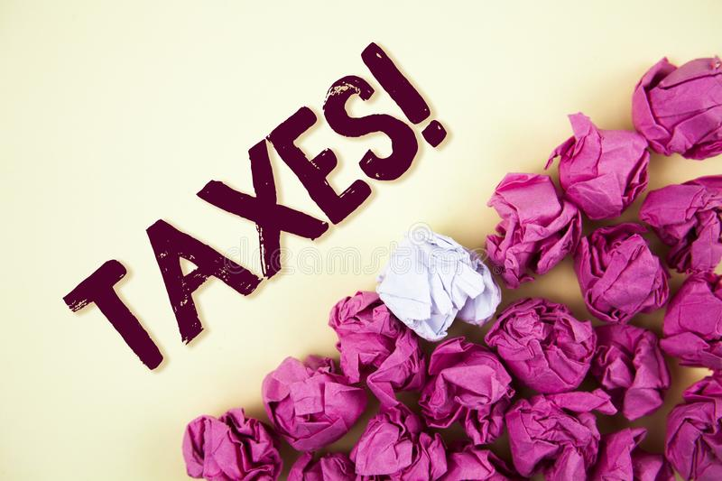 Text sign showing Taxes Motivational Call. Conceptual photo Money demanded by a government for its support written on Plain backgr. Text sign showing Taxes stock photos