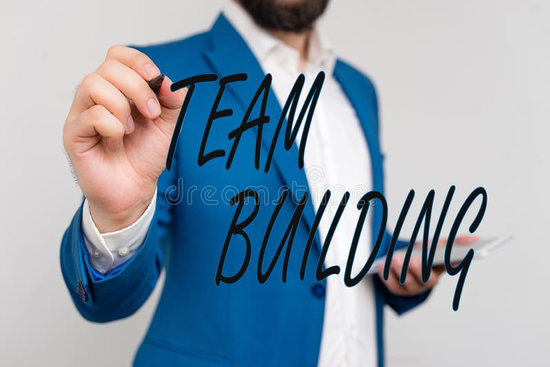 Text sign showing Team Building. Conceptual photo various types of activities used to enhance social relations. Text sign showing Team Building. Business photo royalty free stock photography