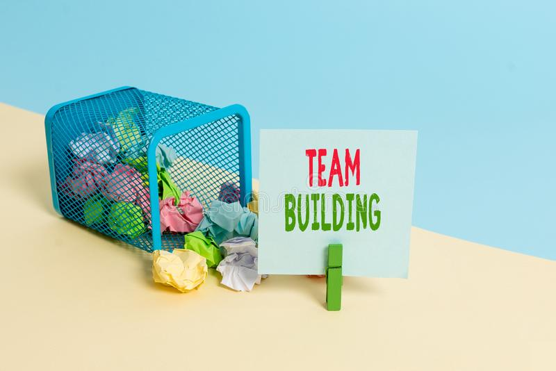 Text sign showing Team Building. Conceptual photo various types of activities used to enhance social relations Trash bin. Text sign showing Team Building royalty free stock images