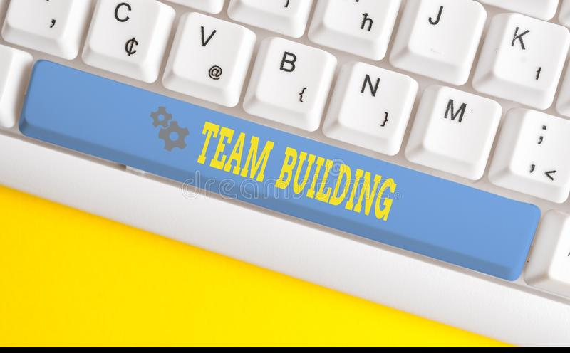 Text sign showing Team Building. Conceptual photo various types of activities used to enhance social relations White pc. Text sign showing Team Building royalty free stock photo