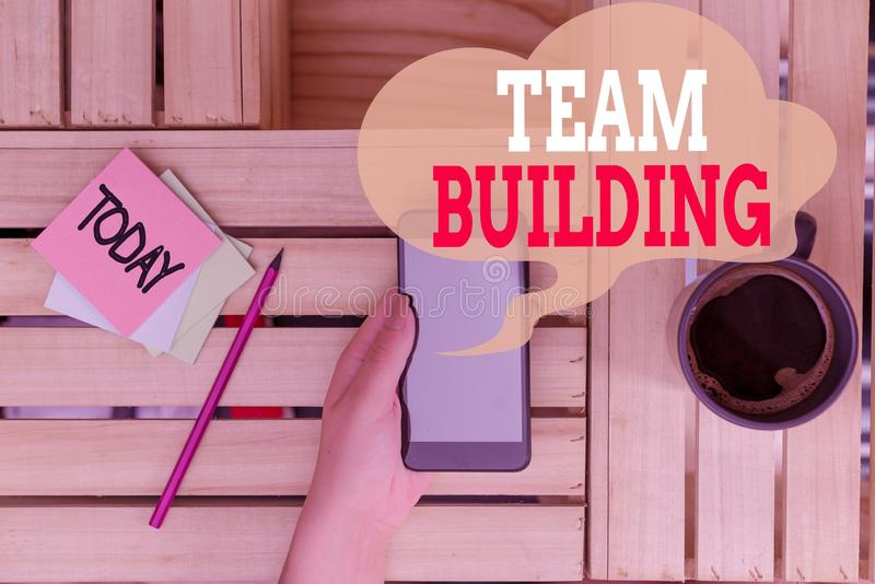 Text sign showing Team Building. Conceptual photo various types of activities used to enhance social relations woman. Text sign showing Team Building. Business stock images