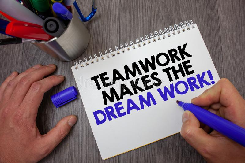 Text sign showing Teamwork Makes The Dream Work Call. Conceptual photo Camaraderie helps achieve success Man hold holding blue mar. Ker notebook page markers royalty free stock images