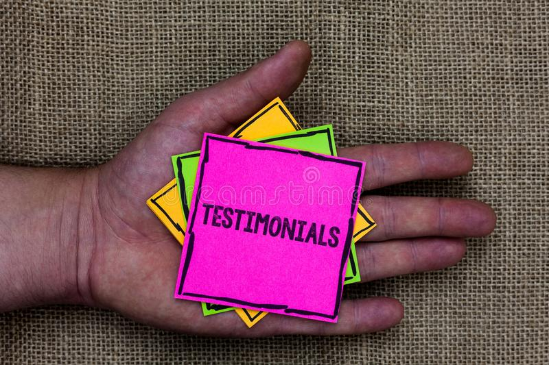 Text sign showing Testimonials. Conceptual photo Customers formal endorsement statement experience of someone Holding small pitche. S art papers thoughts ideas royalty free stock images