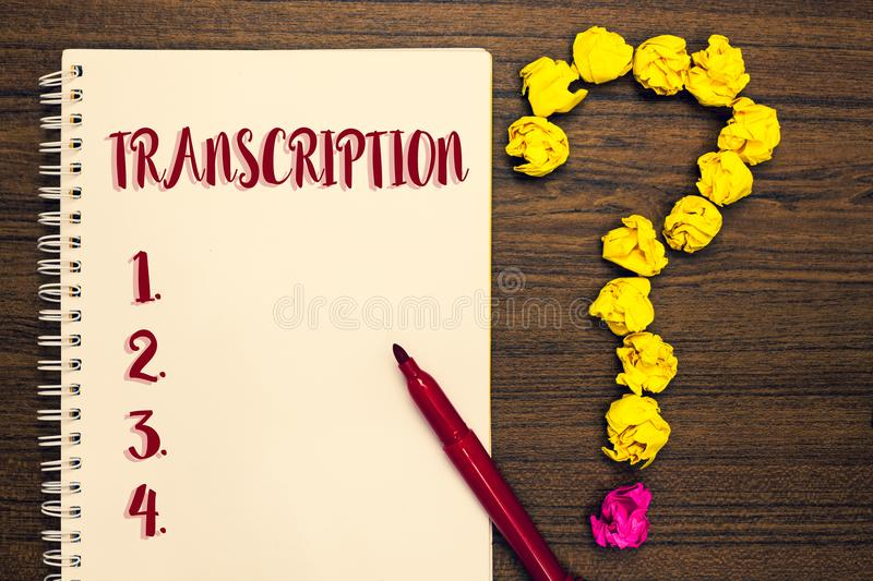 Text sign showing Transcription. Conceptual photo Written or printed process of transcribing words text voice Notepad paperwork ma. Rker pen ask idea pure wood royalty free stock photo