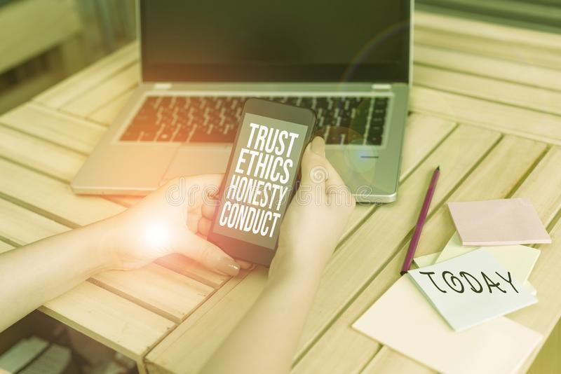Text sign showing Trust Ethics Honesty Conduct. Conceptual photo connotes positive and virtuous attributes woman laptop. Text sign showing Trust Ethics Honesty stock photography