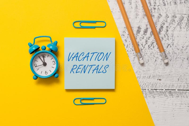 Text sign showing Vacation Rentals. Conceptual photo Renting out of apartment house condominium for a short stay Notepad. Text sign showing Vacation Rentals royalty free stock photography