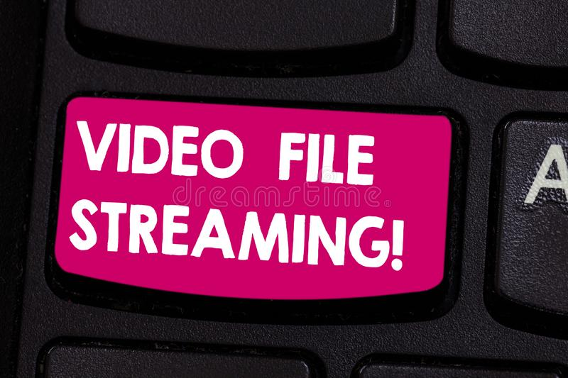 Text sign showing Video File Streaming. Conceptual photo video be viewed online without being downloaded Keyboard key. Intention to create computer message royalty free stock photography