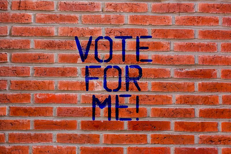 Text sign showing Vote For Me. Conceptual photo Campaigning for a government position in the upcoming election Brick. Wall art like Graffiti motivational call royalty free stock photo