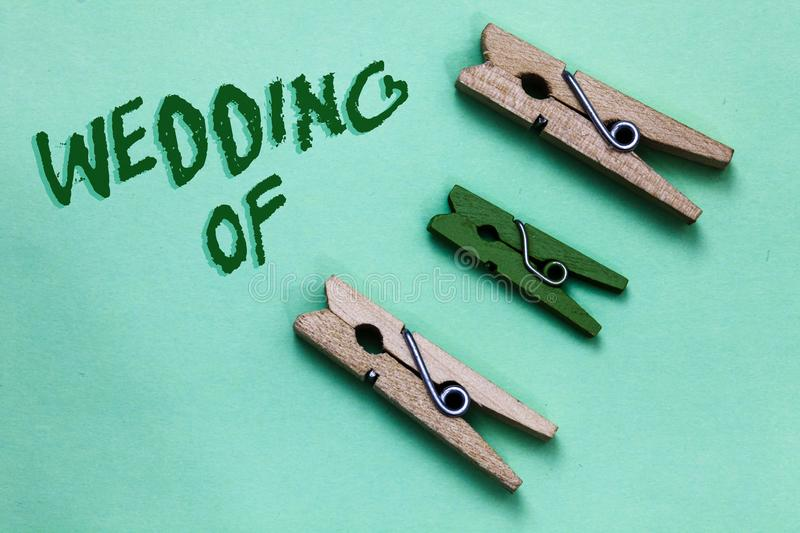 Text sign showing Wedding Of. Conceptual photo announcing that man and woman now as married couple forever Three brown green vinta. Ge clothespins clear stock photos