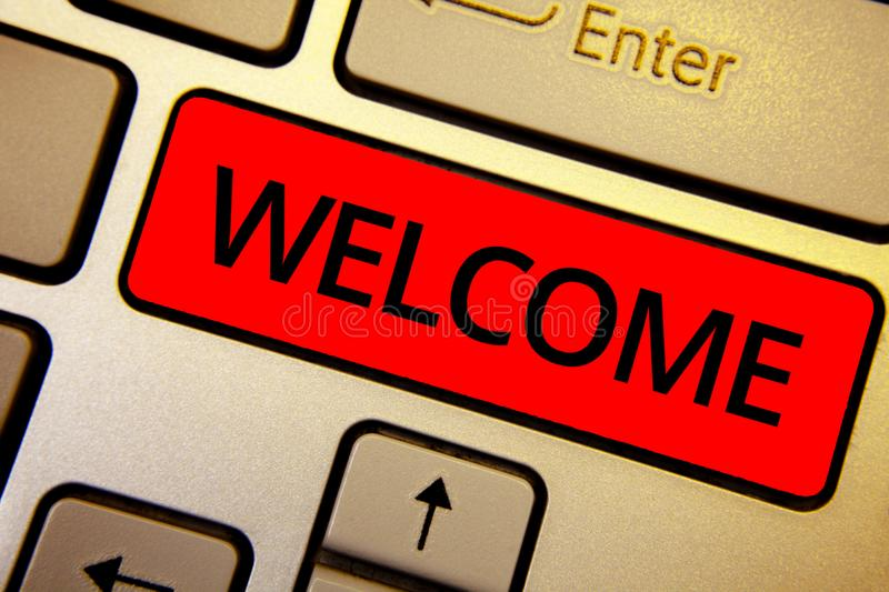 Text sign showing Welcome. Conceptual photo Warm salutation acknowledgement for someone amiable loved thanked Keyboard brown keys. Yellow laptop idea create stock image