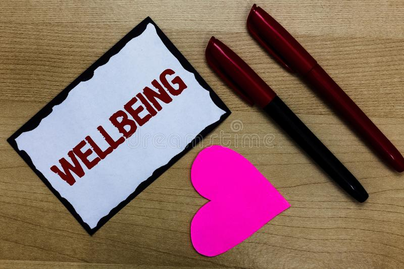 Text sign showing Wellbeing. Conceptual photo Healthy lifestyle conditions of people life work balance Love pure wood colour hart royalty free stock photos