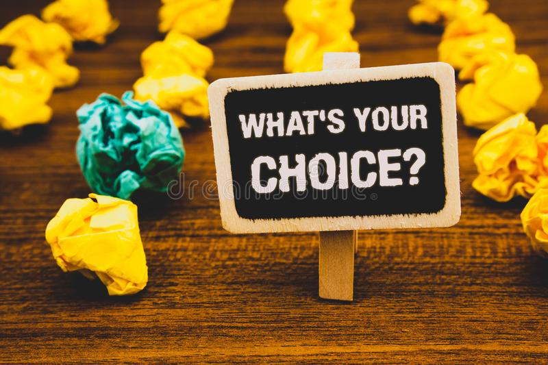Text sign showing What S Your Choice Question. Conceptual photo Option Decision Preferred Opinion Preference Blackboard with lette. Rs wooden floor blurry yellow royalty free stock image