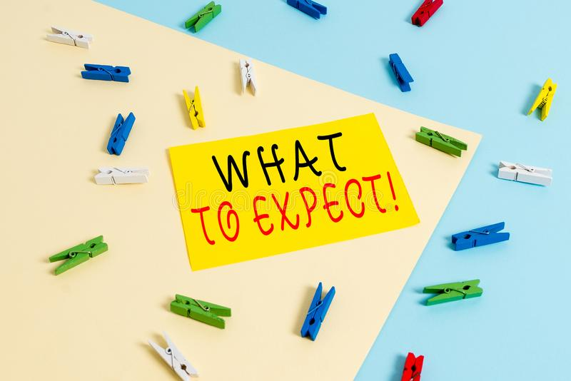 Text sign showing What To Expect. Conceptual photo asking about regard something as likely to happen occur Colored clothespin stock images