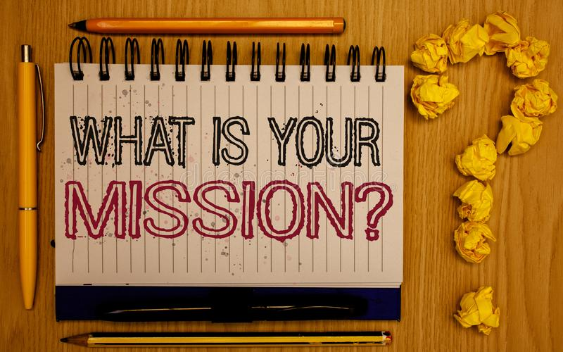 Text sign showing What Is You Mission Question. Conceptual photo asking someone about his plans and to-do list Notepad with outlin. E text pen pencil woody desk royalty free stock photography