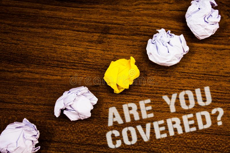 Text sign showing Are You Covered Question. Conceptual photo Have a Security and Health Insurance Medical Care Ideas concepts word. S on wooden background stock image