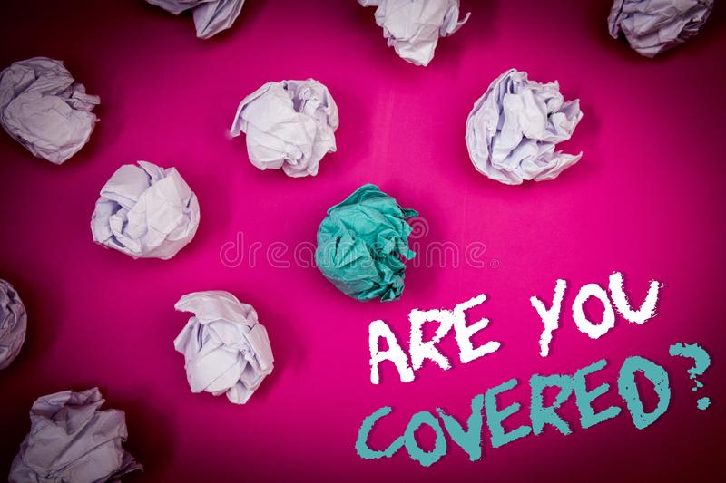 Text sign showing Are You Covered Question. Conceptual photo Have a Security and Health Insurance Medical Care Ideas white blue le. Tters pink background stock photo