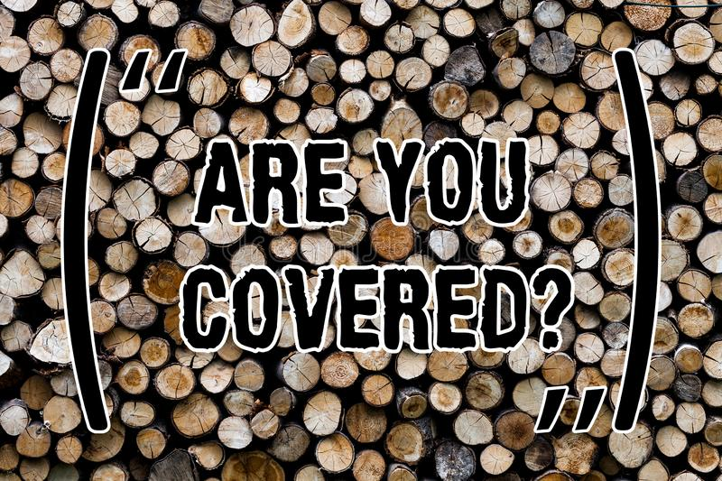 Text sign showing Are You Coveredquestion. Conceptual photo asking about you insurance health statement Wooden background vintage. Wood wild message ideas royalty free stock image
