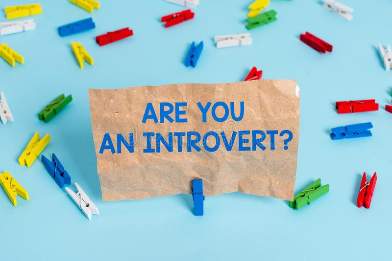 Text sign showing Are You An Introvertquestion. Conceptual photo demonstrating who tends to turn inward mentally Colored. Text sign showing Are You An royalty free stock images