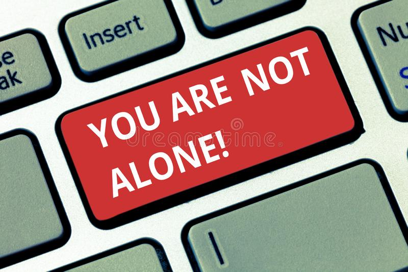 Text sign showing You Are Not Alone. Conceptual photo Offering help support assistance collaboration company Keyboard stock photos