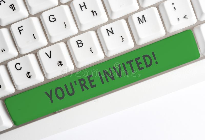 Text sign showing You Re Invited. Conceptual photo make a polite friendly request to someone go somewhere White pc. Text sign showing You Re Invited. Business stock photos
