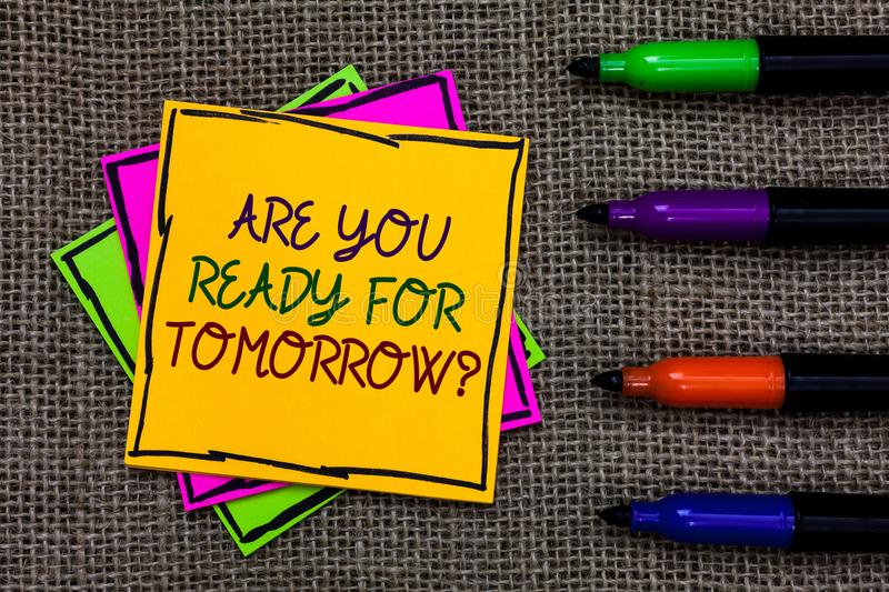 Text sign showing Are You Ready For Tomorrow question. Conceptual photo Preparation to the future Motivation Written on some color. Ful sticky note 4 pens laid royalty free stock image