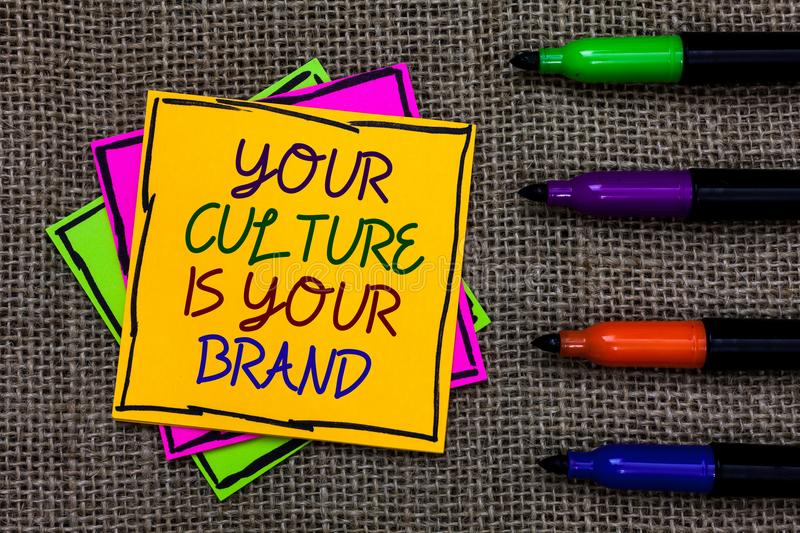 Text sign showing Your Culture Is Your Brand. Conceptual photo Knowledge Experiences are a presentation card Written on some color. Ful sticky note 4 pens laid royalty free stock photography