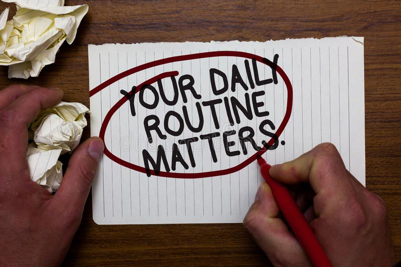 Text sign showing Your Daily Routine Matters. Conceptual photo Have good habits to live a healthy life Hand hold paper. Lob and red pen red circled black words stock photography