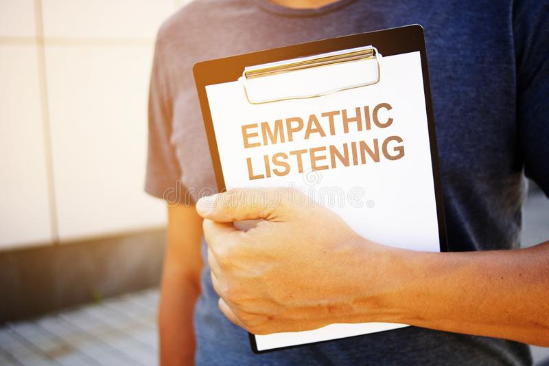 Text sign showing hand writing words Empathic Listening. Text sign shows hand writing words Empathic Listening royalty free stock images