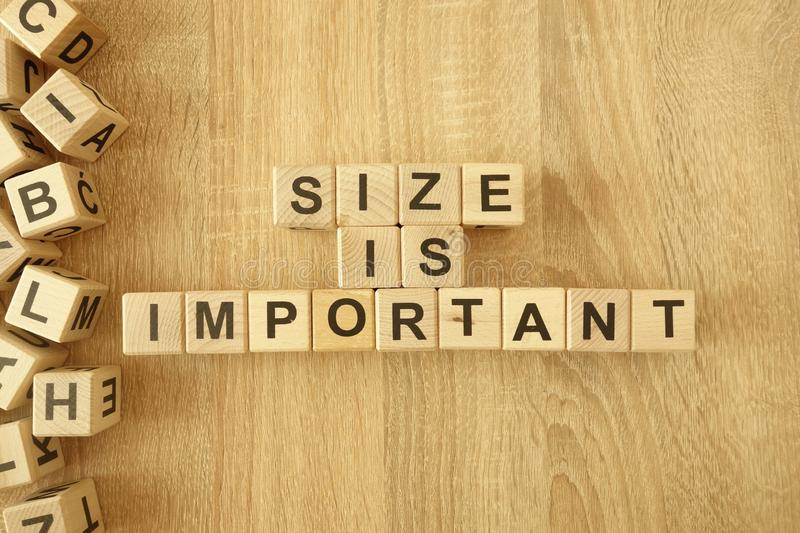 Text size is important from wooden blocks on desk. Background stock photography