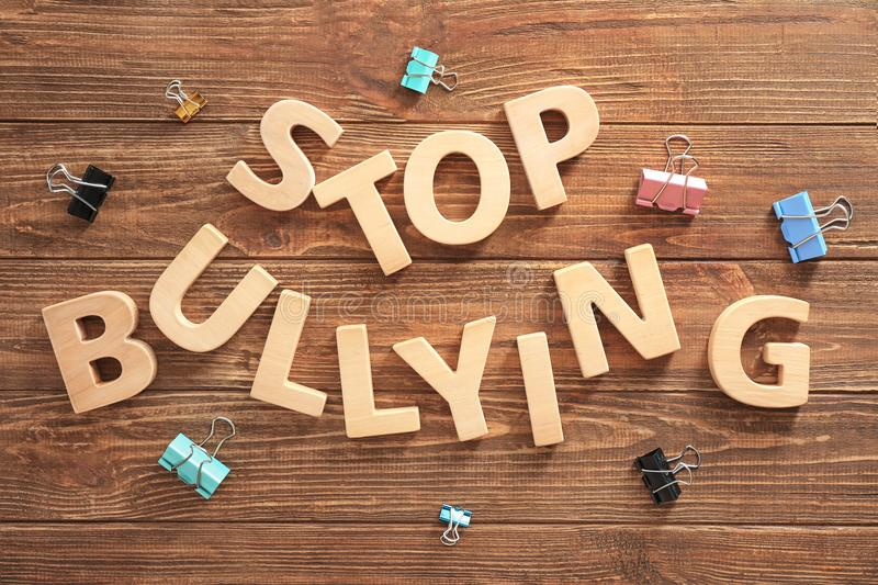 Text `Stop bullying`. Text Stop bullying on wooden background royalty free stock images