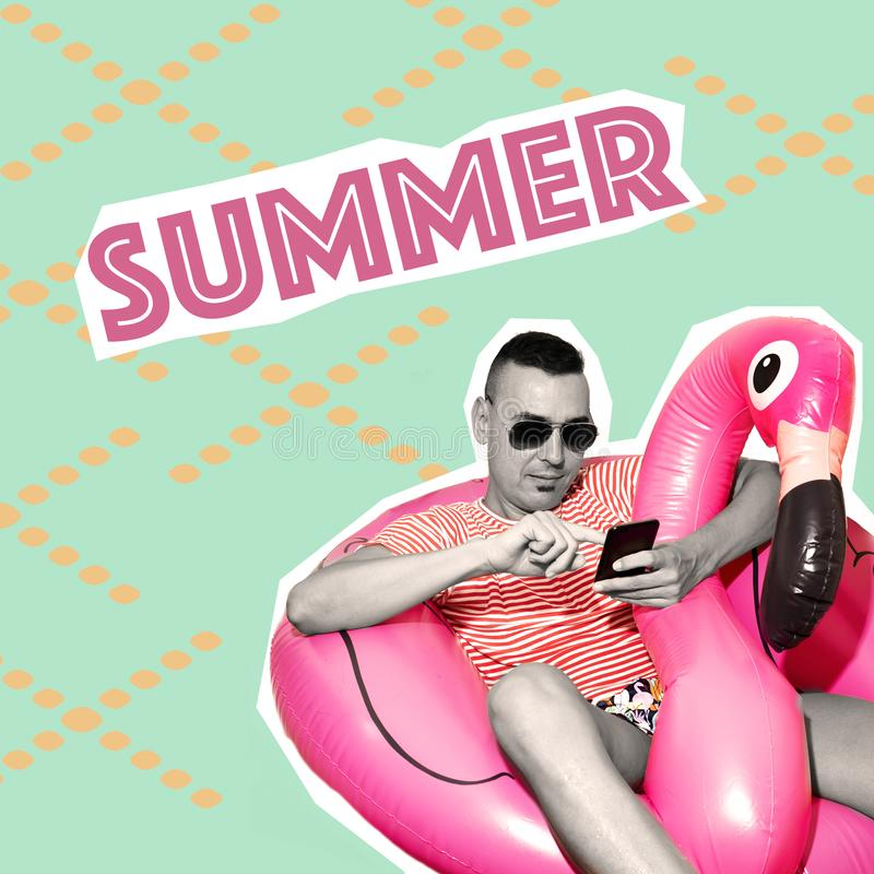 Text summer in a contemporary collage. Text summer, as a magazine cutout, and a young caucasian man wearing swim trunks resting on a flamingo-shaped swim ring royalty free stock images