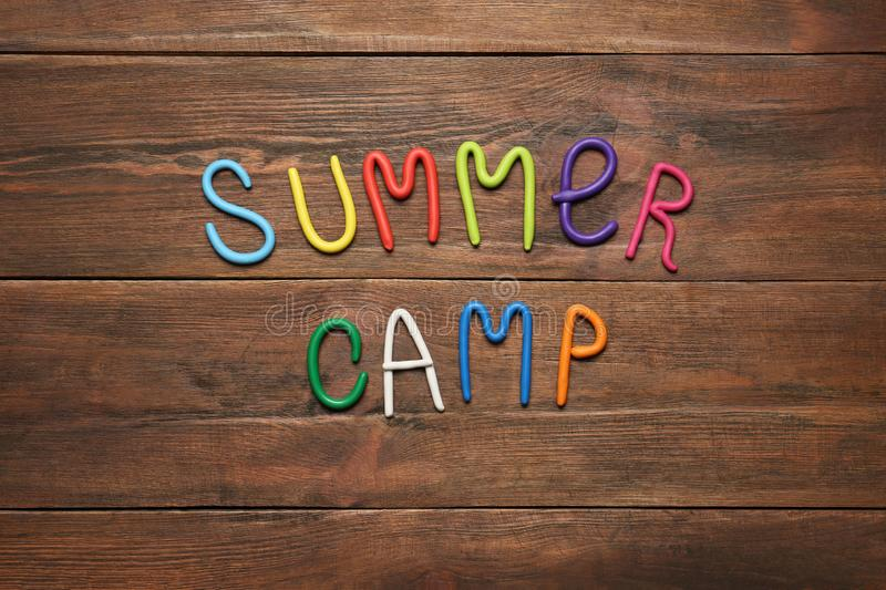 Text SUMMER CAMP made of modelling clay, flat lay stock images