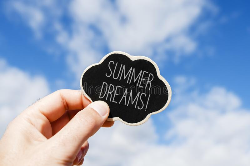 Text summer dreams in a thought bubble royalty free stock photography