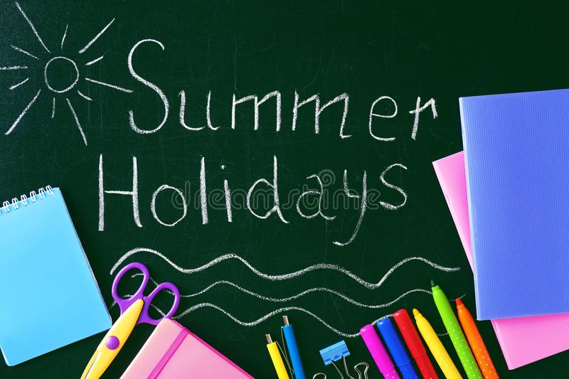 Text SUMMER HOLIDAYS written on chalkboard royalty free stock photography