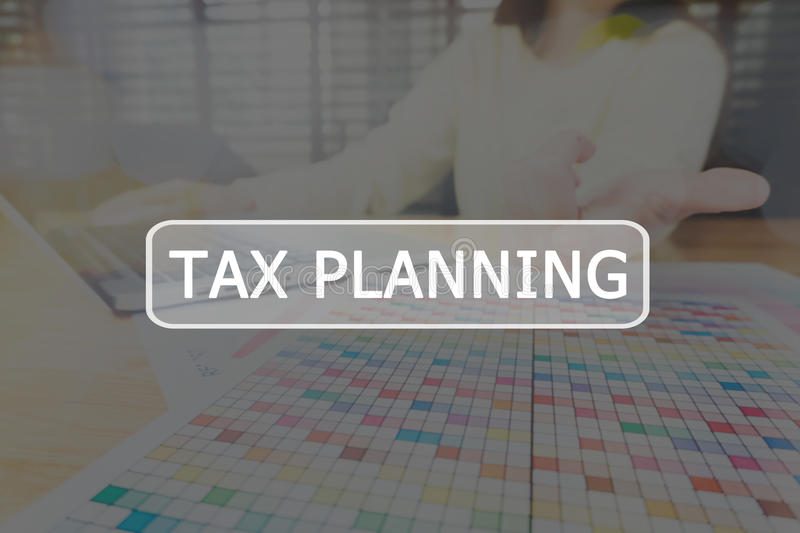 Text Tax planning on background women are working on a computer. The concept of working with a lot of information. Text Tax planning on background women are stock image