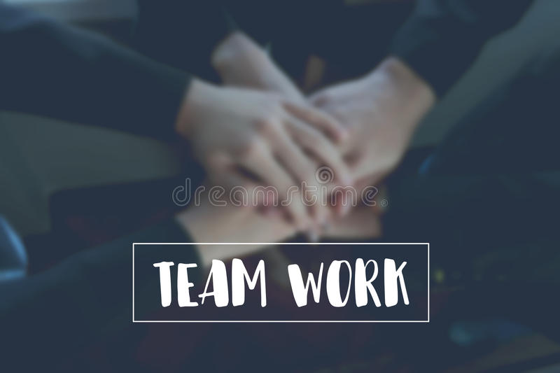Text teamwork on background Hand coordination of the team Represents collaboration.  royalty free stock photo