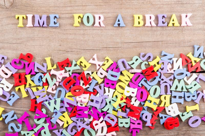 Text `Time for a break` of colored wooden letters stock images
