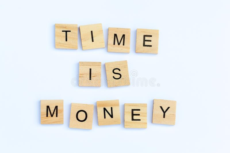 Text - Time is Money. Text - `Time is Money` on a white background royalty free stock image