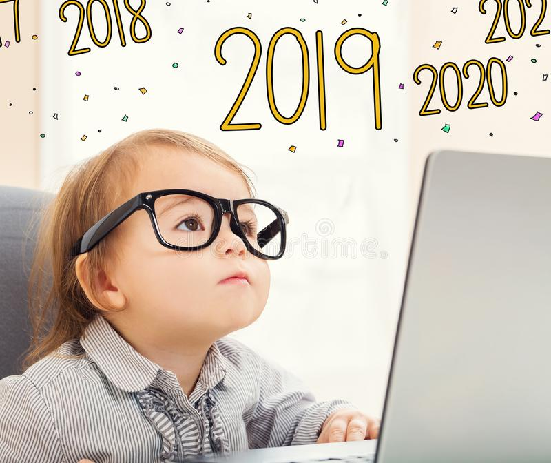2019 text with toddler girl stock photo