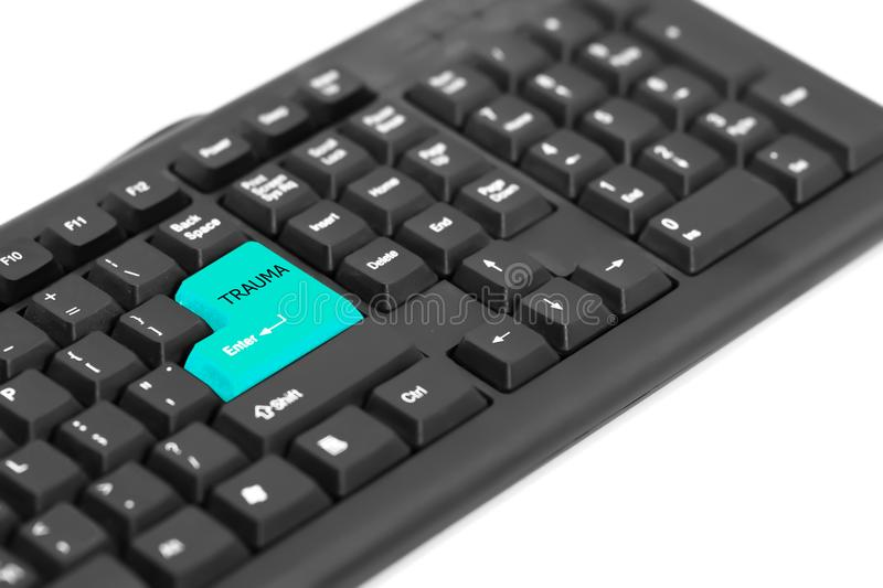 Text TRAUMA on keyboard sign for hard work. Text TRAUMA on green enter on keyboard. Concept Disturbing physical from hard working royalty free stock photo
