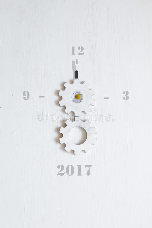 Text 2017 on the white background. Inscription 2017 on the white background and gears royalty free stock photos