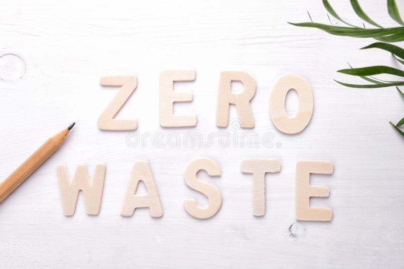 Text zero waste with green leaves on white background royalty free stock images