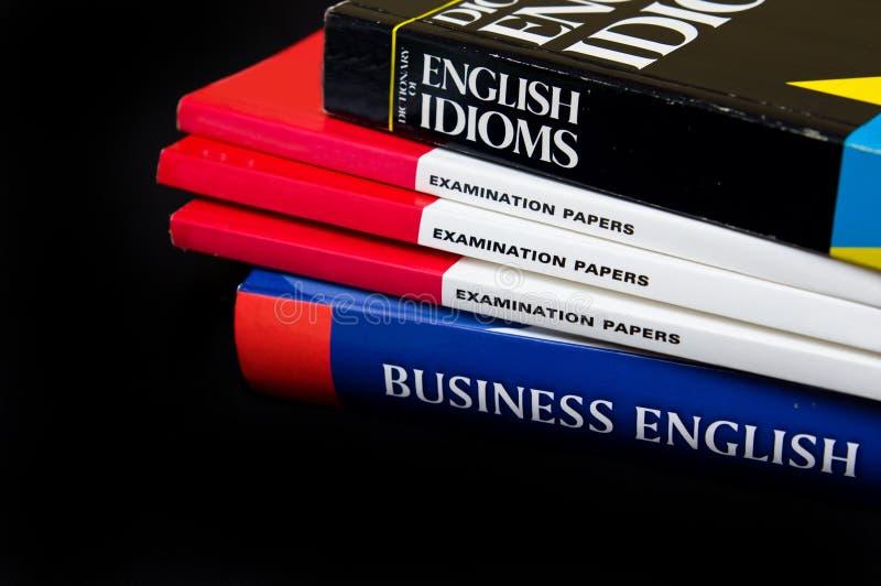Textbooks. Stack of English language books. Isolated against a black background stock image