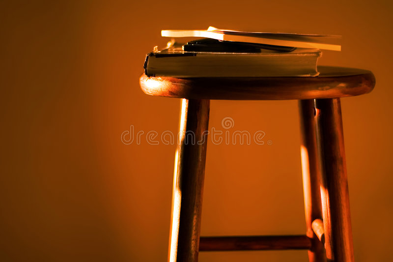 Textbooks and calculator on stool royalty free stock photo