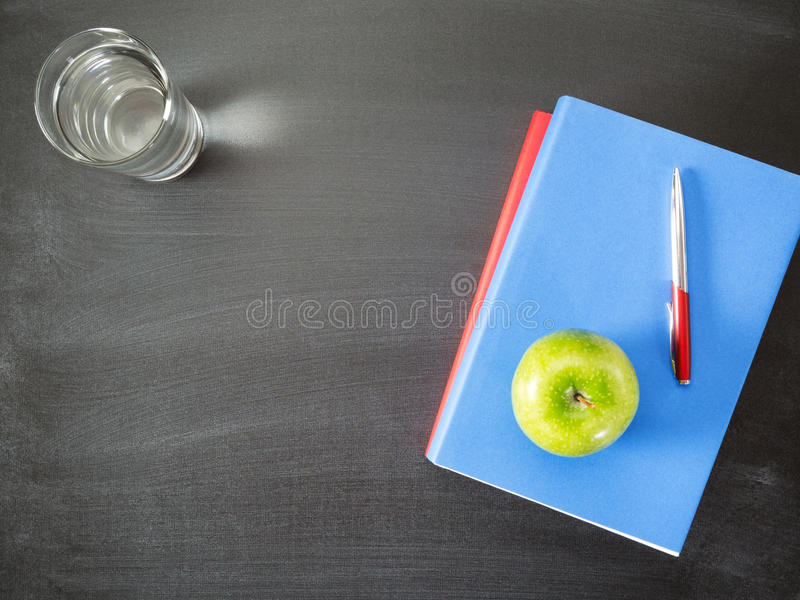 Textbooks and a Snack - Doing Homework royalty free stock images