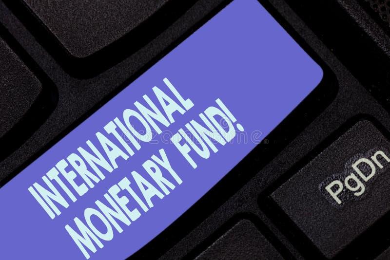Texte d'écriture écrivant le Fonds monétaire international La signification de concept favorise la stabilité financière internati photographie stock libre de droits