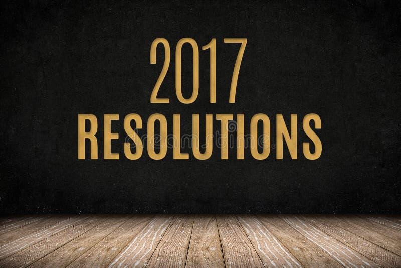 texte d'or de 2017 résolutions sur le mur de tableau noir sur le floo en bois de planche photographie stock